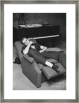 Elvis Presley At Home By His Piano 1956 Framed Print by The Phillip Harrington Collection