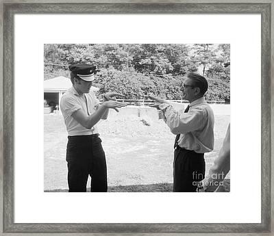 Elvis Presley Horsing Around With A Reporter 1956 Framed Print by The Phillip Harrington Collection