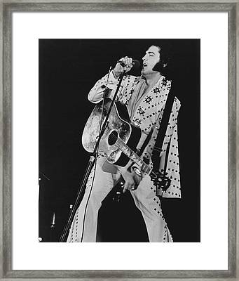 Elvis Presley Sings Framed Print by Retro Images Archive
