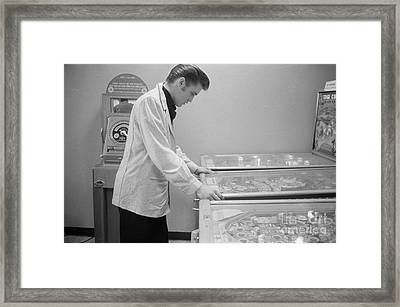 Elvis Presley Playing Pinball 1956 Framed Print by The Harrington Collection