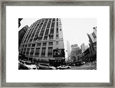 Empire State Building Shrouded In Mist As Yellow Cabs Crossing Crosswalk On 7th Ave And 34th Street Framed Print by Joe Fox