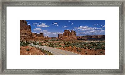 Empty Road Running Through A National Framed Print by Panoramic Images