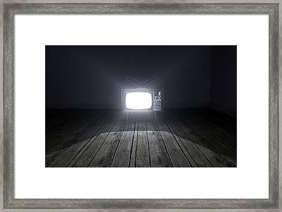 Empty Room With Illuminated Television Framed Print by Allan Swart