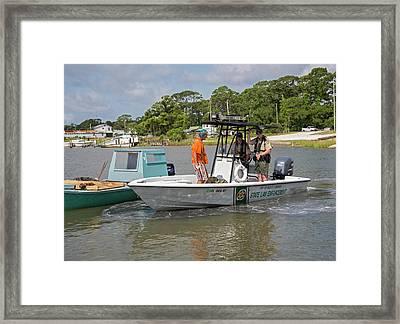 Enforcing Oyster Harvesting Regulations Framed Print by Jim West