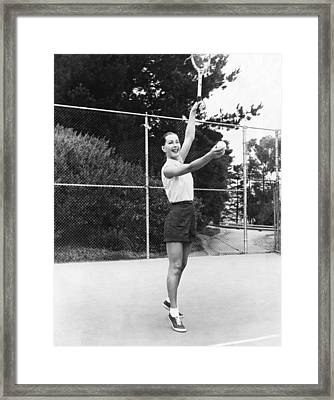 Evelyn Frey Playing Tennis Framed Print by Bill Young
