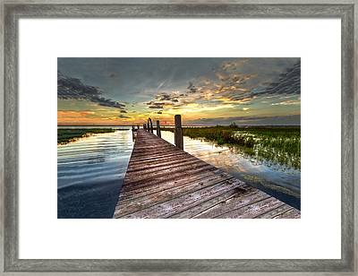 Evening Dock Framed Print by Debra and Dave Vanderlaan