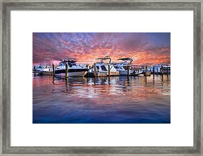Evening Harbor Framed Print by Debra and Dave Vanderlaan