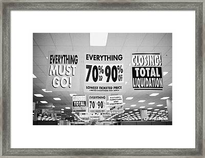 everything must go total liquidation closing signs in a store in Saskatoon saskatchewan canada Framed Print by Joe Fox