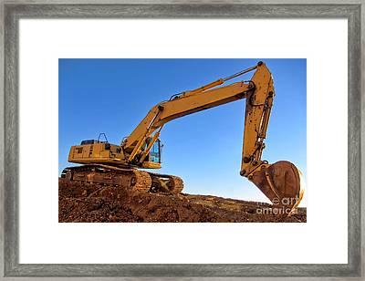 Excavator Framed Print by Olivier Le Queinec