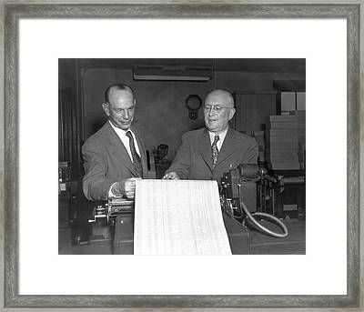 Executives Viewing Data Sheets Framed Print by Underwood Archives