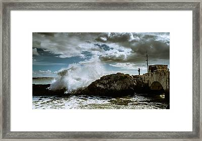 Extreme Fishing Framed Print by Marco Oliveira