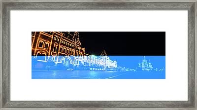 Facade Of A Building Lit Up At Night Framed Print by Panoramic Images
