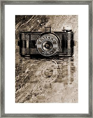 Falcon Miniature Camera With Water Framed Print by Jon Woodhams