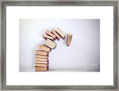 Falling Books Framed Print by Viktor Pravdica