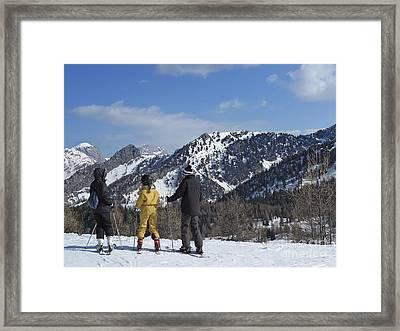 Family On Ski Contemplating Mountains Framed Print by Sami Sarkis