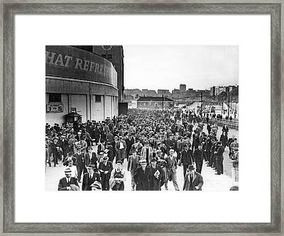 Fans Leaving Yankee Stadium. Framed Print by Underwood Archives
