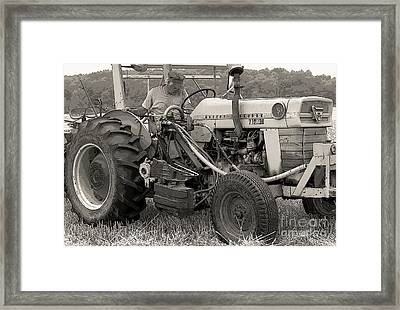 Farmer And His Tractor Framed Print by Kathleen Struckle