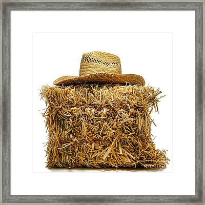 Farmer Hat On Hay Bale Framed Print by Olivier Le Queinec