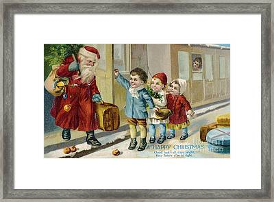 Father Christmas Disembarking Train Framed Print by Mary Evans