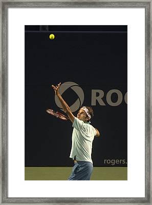 Federer's Serve Framed Print by Bill Cubitt