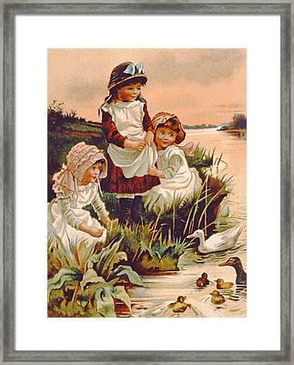 Feeding Ducks Framed Print by Edith S Berkeley
