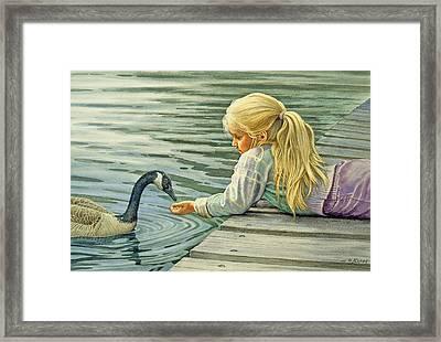 Feeding The Canada Goose Framed Print by Paul Krapf