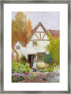 Feeding The Cat Framed Print by Arthur Claude Strachan