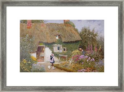Feeding The Pigeons Framed Print by Arthur Claude Strachan