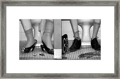 Feet In Toilet Stalls Framed Print by Novastock