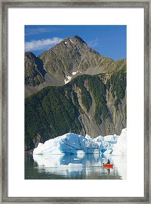 Female Canoeist Paddles Amongst The Framed Print by Michael DeYoung