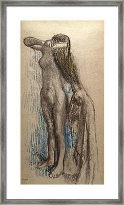 Femme Se Coiffant Framed Print by Edgar Degas