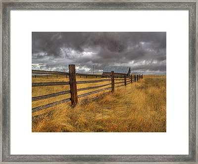 Fence Line In Storm Framed Print by Jean Noren