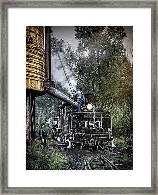 Filling The Tender Framed Print by Ken Smith
