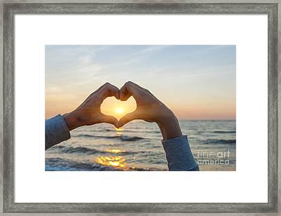 Fingers Heart Framing Ocean Sunset Framed Print by Elena Elisseeva