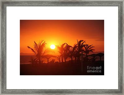 Fire Ball Sunset Framed Print by Bob Hislop