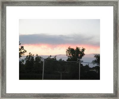 Fire In The Sky Framed Print by Suzanne Perry