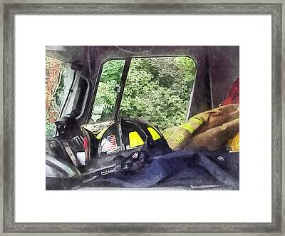Firemen - Helmet Inside Cab Of Fire Truck Framed Print by Susan Savad