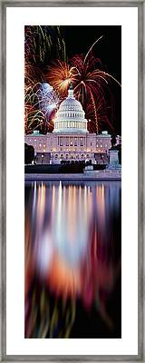 Firework Display Over A Government Framed Print by Panoramic Images