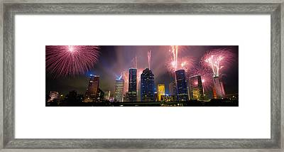 Fireworks Over Buildings In A City Framed Print by Panoramic Images