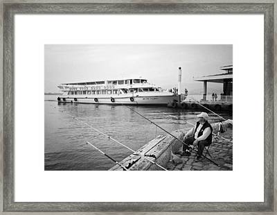 Fisherman At Alsancak Framed Print by Ilker Goksen