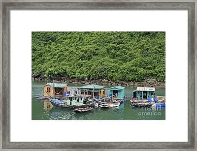 Fisherman Floatting Houses Framed Print by Sami Sarkis