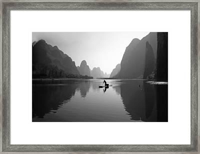 Fisherman In Li River Framed Print by King Wu