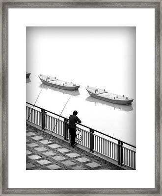 Fisherman Waiting Framed Print by Valentino Visentini