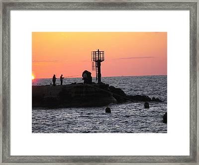 Fishermen At Sunset Framed Print by Lionel Gaffen