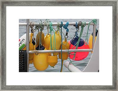 Fishing Boat Floats Framed Print by Jim West