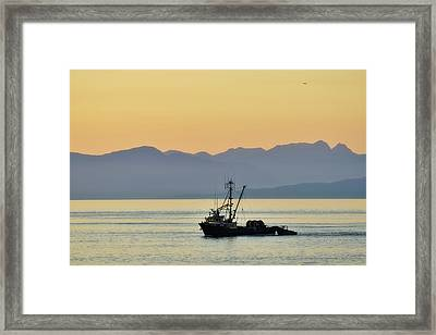 Fishing Boat Seen At Sunset Framed Print by Matt Freedman