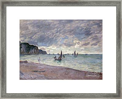 Fishing Boats In Front Of The Beach And Cliffs Of Pourville Framed Print by Claude Monet