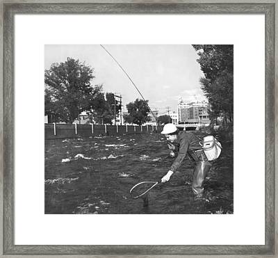 Fishing In The City Framed Print by Underwood Archives