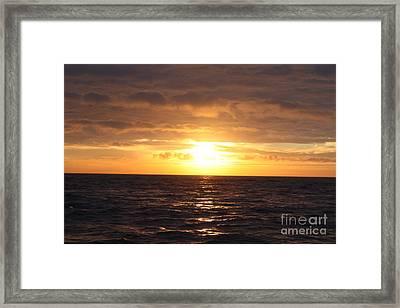 Fishing Into The Sunrise Framed Print by John Telfer