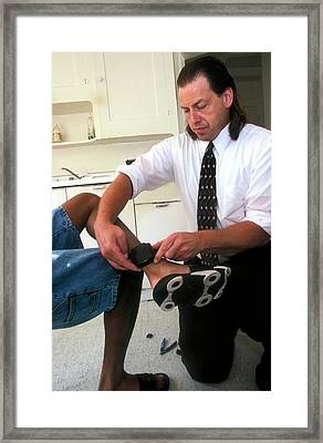 Fitting Electronic Monitoring Device Framed Print by Jim West